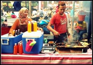Man selling tawa kebabs